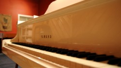 white yamaha c7 grand piano in recording studio, music, video, photos